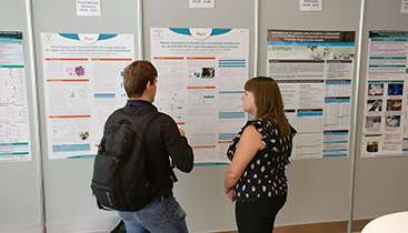 People looking at the Conference poster catch-up
